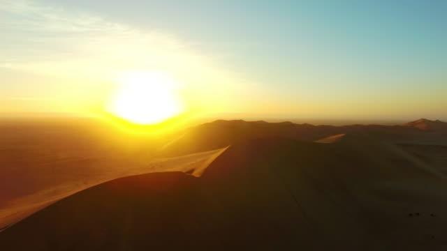 sunrise over the namib desert - namibian desert stock videos and b-roll footage