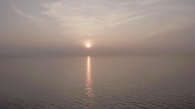 sunrise over the ocean / samcheok-si, gangwon-do, south korea - grainy stock videos & royalty-free footage