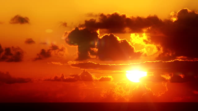 sunrise over the ocean - red cloud sky stock videos & royalty-free footage