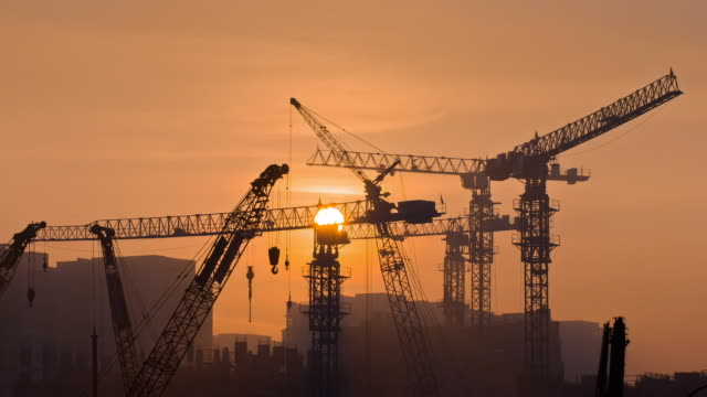 sunrise over the tower cranes - fast motion stock videos & royalty-free footage