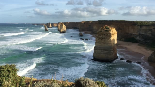 sunrise over the twelve apostles at port campbell national park great ocean road in victoria australia - port campbell national park stock videos & royalty-free footage