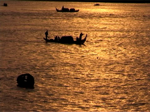 sunrise over tonle sap river - capital cities stock videos & royalty-free footage