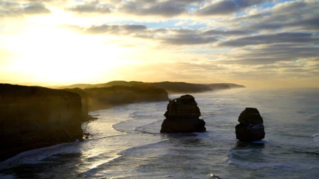 sunrise over twelve apostles marine national park australia - fog stock videos & royalty-free footage