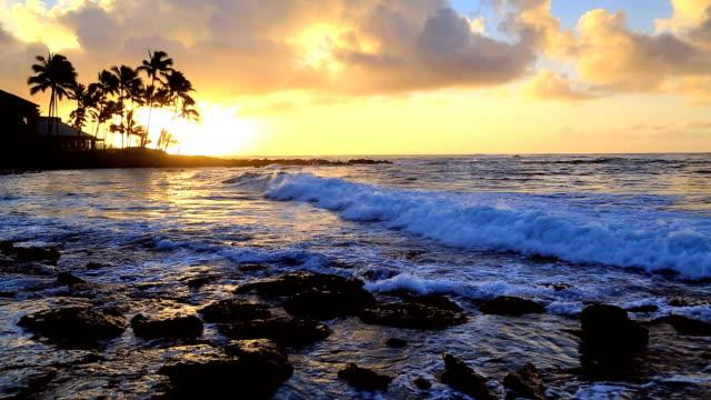 sunrise over water in kauai, hawaii - kauai stock videos and b-roll footage