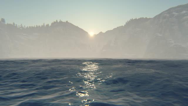 vidéos et rushes de lever de soleil sur l'eau - horizon over water