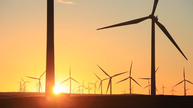 sunrise over whitelee wind farm on eaglesham moor just south of glasgow in scotland, uk, is europes largest onshore wind farm with 140 turbines and an installed capacity of 322 mw, enough energy to power 180,000 homes. - propeller stock videos & royalty-free footage