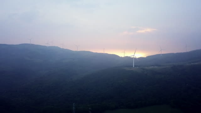 sunrise over wind turbines of daegwallyeong mountain pass, gangwon province, south korea - gegenlicht stock-videos und b-roll-filmmaterial