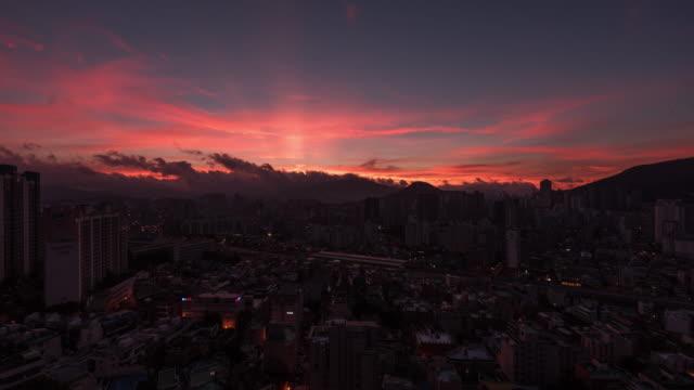 stockvideo's en b-roll-footage met sunrise over yeonje-gu district downtown area / yeonje-gu, busan, south korea - vrijstaand huis