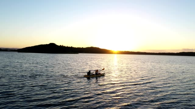 sunrise paddle on the lake - reportage stock videos & royalty-free footage