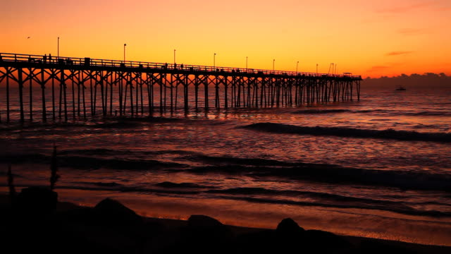 sunrise pier with boat - gulf coast states stock videos & royalty-free footage