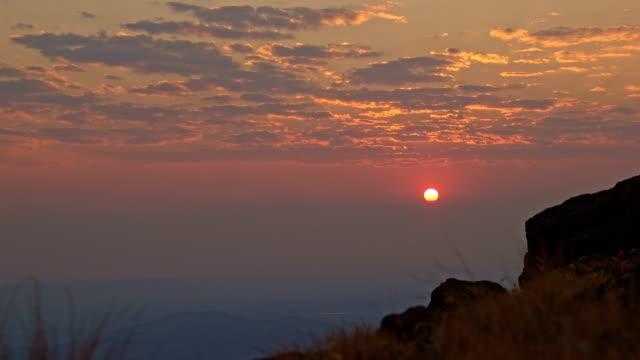 Sunrise red sun peeking through clouds over Alvord Desert from summit of Steens Mountain 2