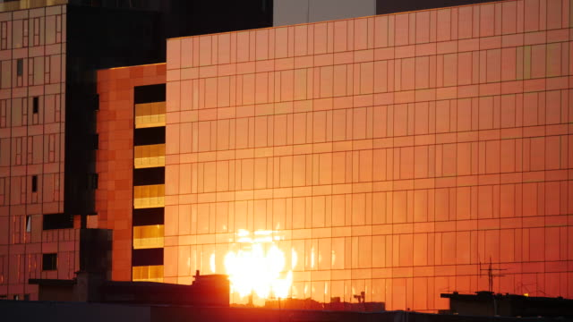 sunrise reflection on windows - twilight stock videos & royalty-free footage