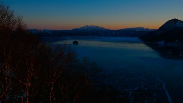 T/L, WS, sunrise reveal of Lake Mashu in winter / Akan National Park, Hokkaido, Japan