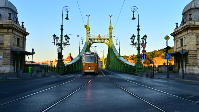sunrise scene of budapest tram public transport with liberty bridge, budapest, hungary - liberty bridge budapest stock videos & royalty-free footage
