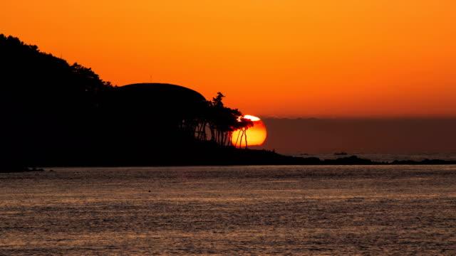sunrise scenery of nurimaru apec house /  haeundae-gu, busan, south korea - omega sun mirage stock videos & royalty-free footage