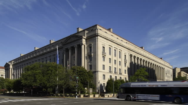 sunrise shot showing the justice department building and light traffic on pennsylvania avenue in washington, dc - department of justice stock videos & royalty-free footage