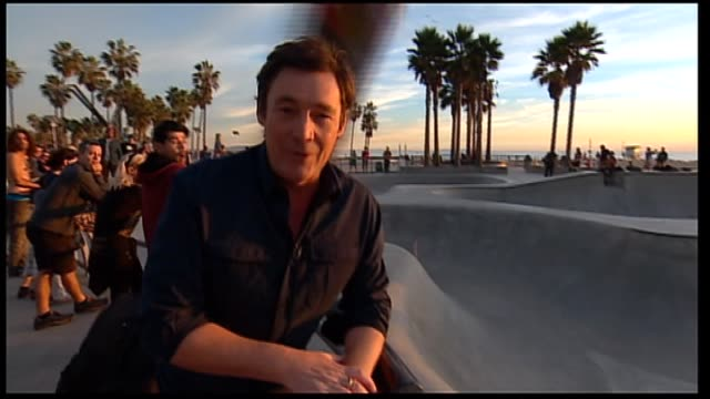 sunrise studio monique wright and andrew o'keefe split screen live cross to 7 news reporter mike amor who was hit in the head by a flying skateboard... - ausrutscher stock-videos und b-roll-filmmaterial