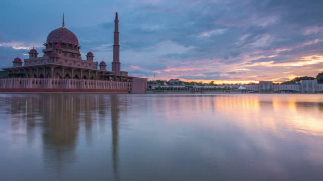 sunrise time lapse at a mosque by a lake in malaysia - putrajaya stock videos & royalty-free footage