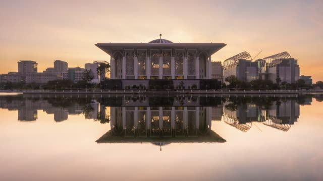 sunrise time lapse at a mosque by a lake - putrajaya stock videos & royalty-free footage