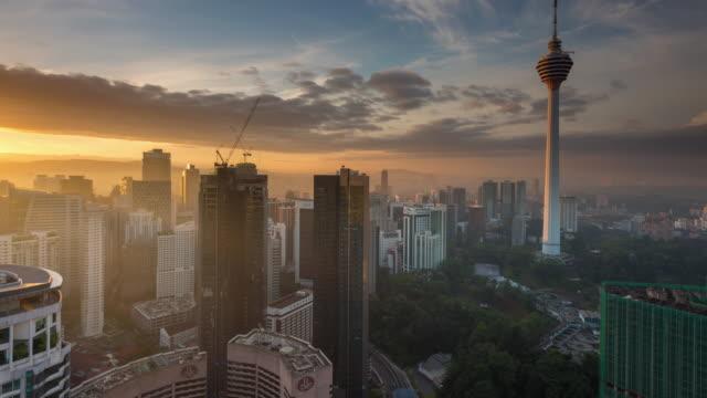 sunrise time lapse at kuala lumpur tower - menara kuala lumpur tower stock videos & royalty-free footage