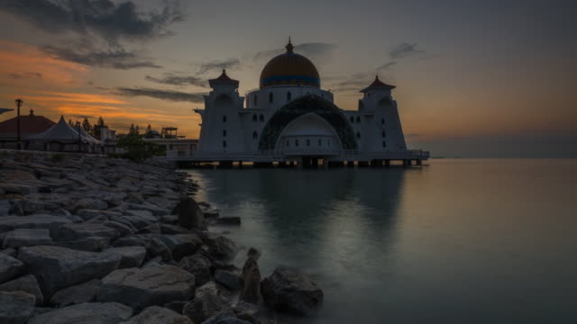 sunrise time lapse at malacca straits mosque - straits stock videos and b-roll footage