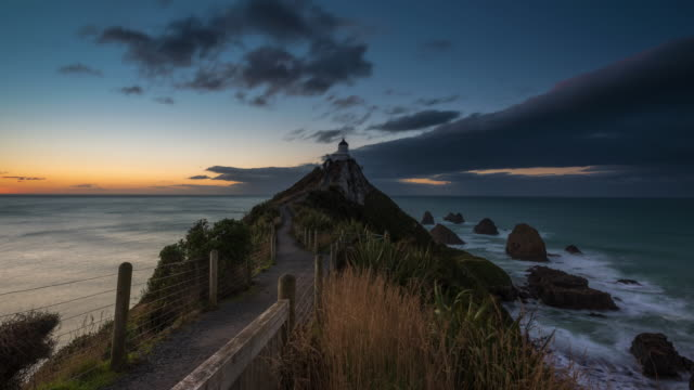 Sunrise Time Lapse at Nugget Point Lighthouse, New Zealand