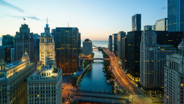Sunrise time lapse of Chicago cityscape and river towards Lake Michigan