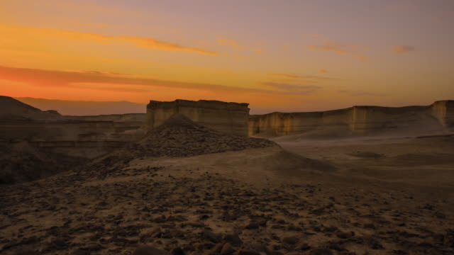 Sunrise time lapse of sand dunes and cliffs