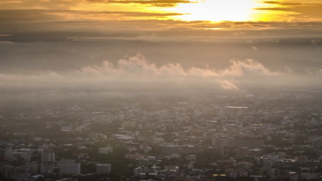 sunrise time lapse with city of mist time-lapse , chiang mai city with mist in the morning after sunrise formation of cloud , uhd format - smog stock videos and b-roll footage