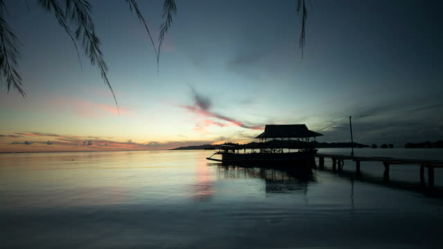 Sunrise time lapse with jetty in Sulawesi Indonesia