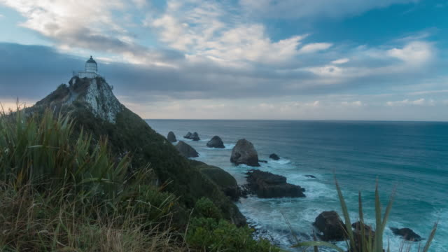 sunrise timelapse at nugget point lighthouse, new zealand - otago region stock videos & royalty-free footage