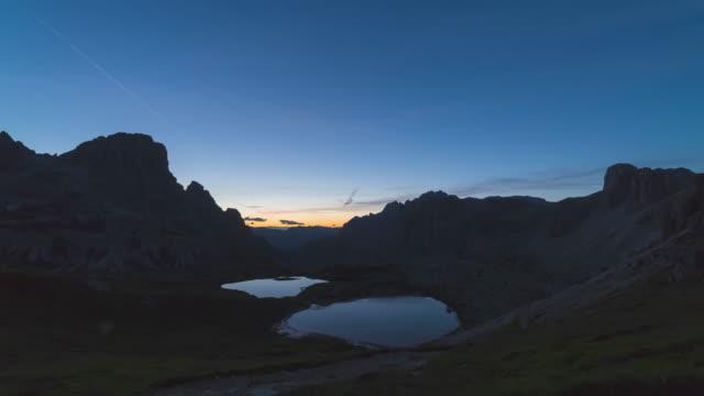 T/L Sunrise Timelapse at the Lakes Piani / Laghi del Piani near Tre Cime di Lavaredo in the Dolomites, Italy