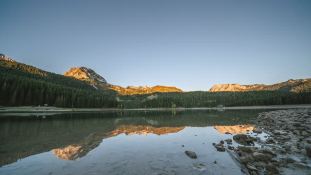 sunrise timelapse near a lake in durmitor national park - durmitor national park stock videos & royalty-free footage