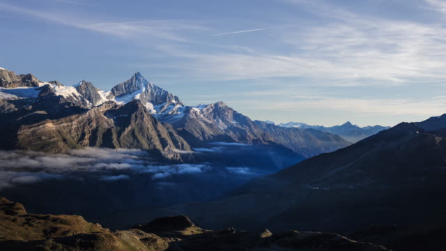 sunrise timelapse of a sea of clouds above zermatt switzerland - mountain stock videos & royalty-free footage