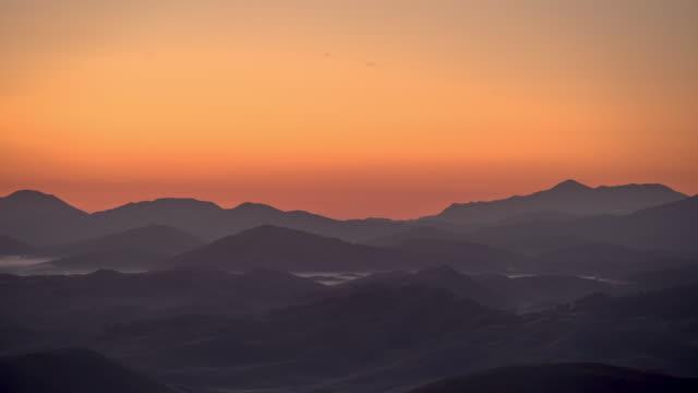 sunrise timelapse of a vast landscape in durmitor national park - durmitor national park stock videos & royalty-free footage