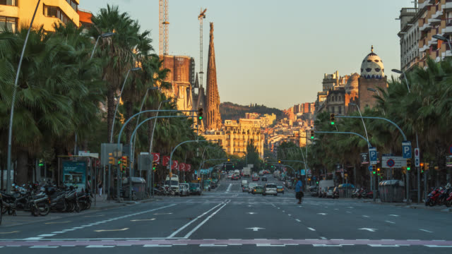 sunrise timelapse of city car traffic on the street near sagrada familia in barcelona, spain. - zebra crossing stock videos & royalty-free footage