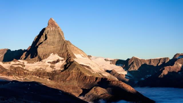 sunrise timelapse of the matterhorn with alpenglow - natural landmark stock videos & royalty-free footage