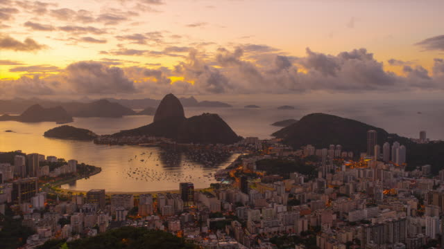 sunrise time-lapse overlooking rio de janeiro and sugarloaf mountain. - rio de janeiro stock videos and b-roll footage