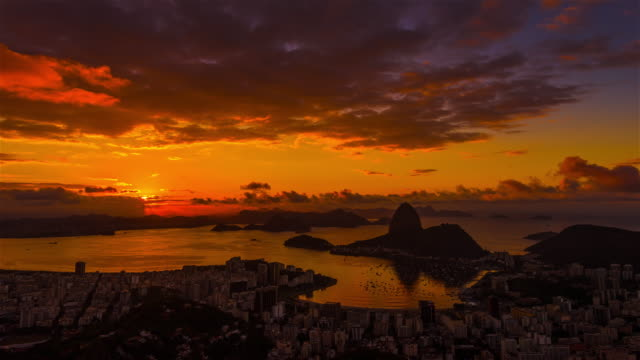 sunrise time-lapse overlooking rio de janeiro and sugarloaf mountain. - bay of water stock videos & royalty-free footage
