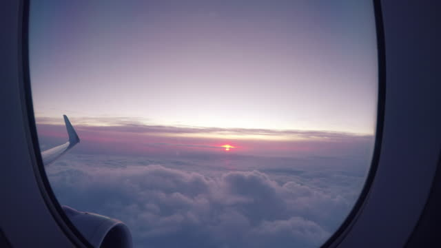 sunrise view from airplane window - commercial airplane stock videos & royalty-free footage