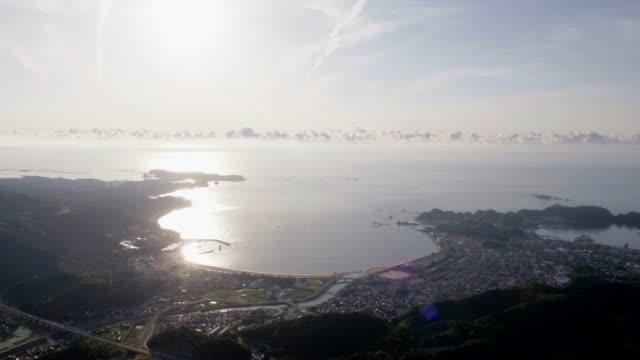 sunrise view of a coastal village in taiji, wakayama, japan - village点の映像素材/bロール