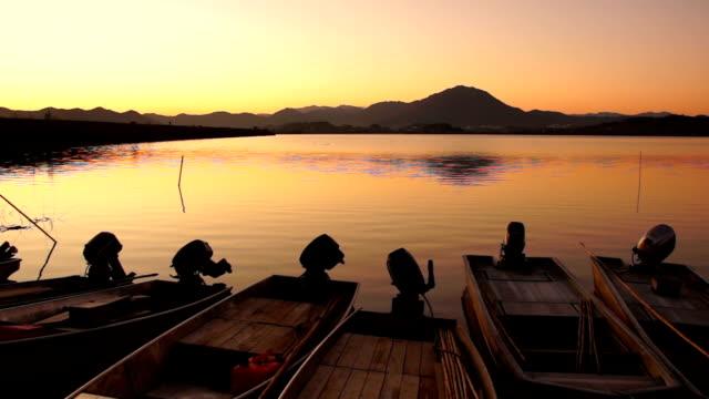 Sunrise View of anchored narrow boats at Junamjeosuji Reservoir