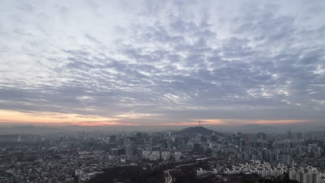 stockvideo's en b-roll-footage met sunrise view of city buildings around the seoul fortress wall and n seoul tower(tourist spot) in seoul - breed