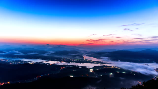 Sunrise view of cityscape under clouds at Dumulmeori (Two water area) (Popular travel destination and Drama location) in Yebinsan mountain, Gyeonggi-do
