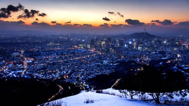 Sunrise view of downtown Seoul seen from Inwangsan Mountain in Jongno-gu during winter