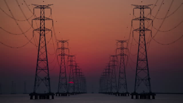 Sunrise view of electricity pylon at Sihwaho lake