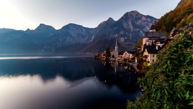 Sunrise view of Hallstatt mountain village with Hallstatter lake, Austria. Timelapse