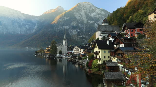 sunrise view of hallstatt mountain village with hallstatter lake, austria. timelapse - traditionally austrian stock videos & royalty-free footage