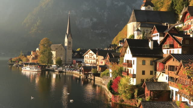 sunrise view of hallstatt mountain village with hallstatter lake, austria. timelapse - austria stock videos & royalty-free footage