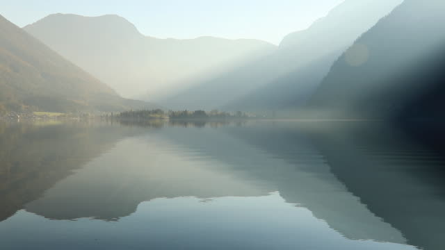 sunrise view of hallstatter lake, austria. - salzkammergut stock videos and b-roll footage